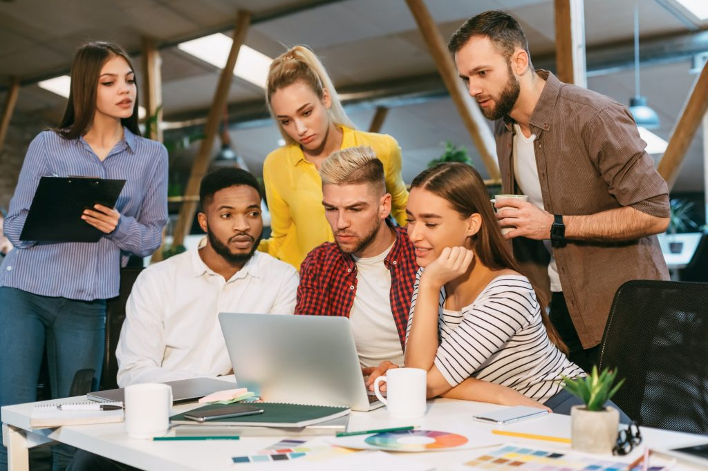 Freelance web designers brainstorming together in office